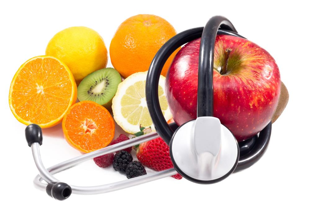 Red Apple and stethoscope and  fruits  background