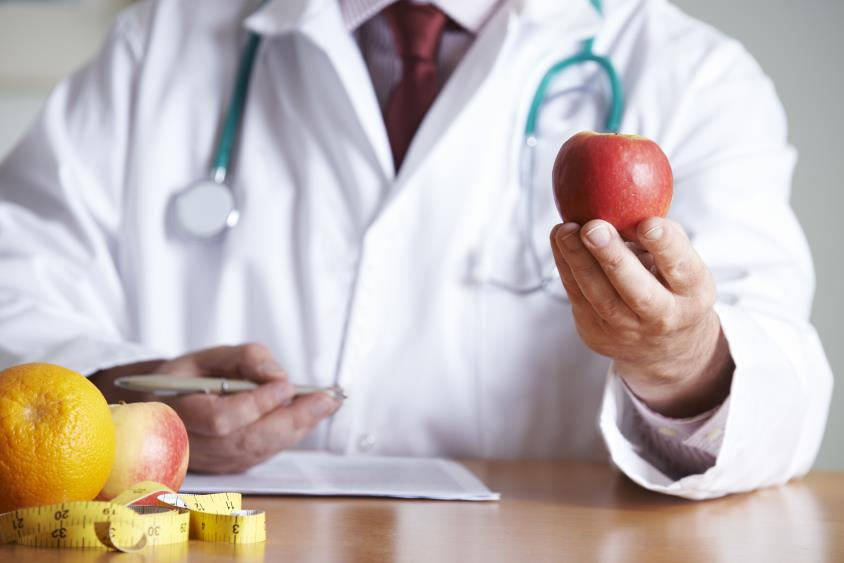 Doctor Giving Advice On Healthy Diet